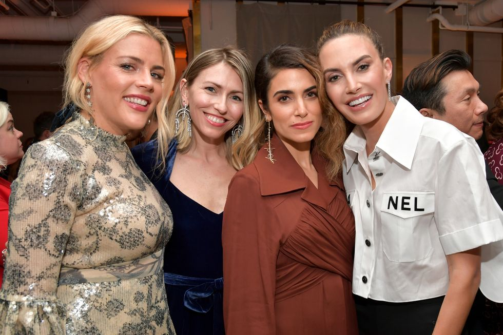 Busy Philipps and a fellow Change Makers party guest are seen with Nikki Reed and Elizabeth Chambers.