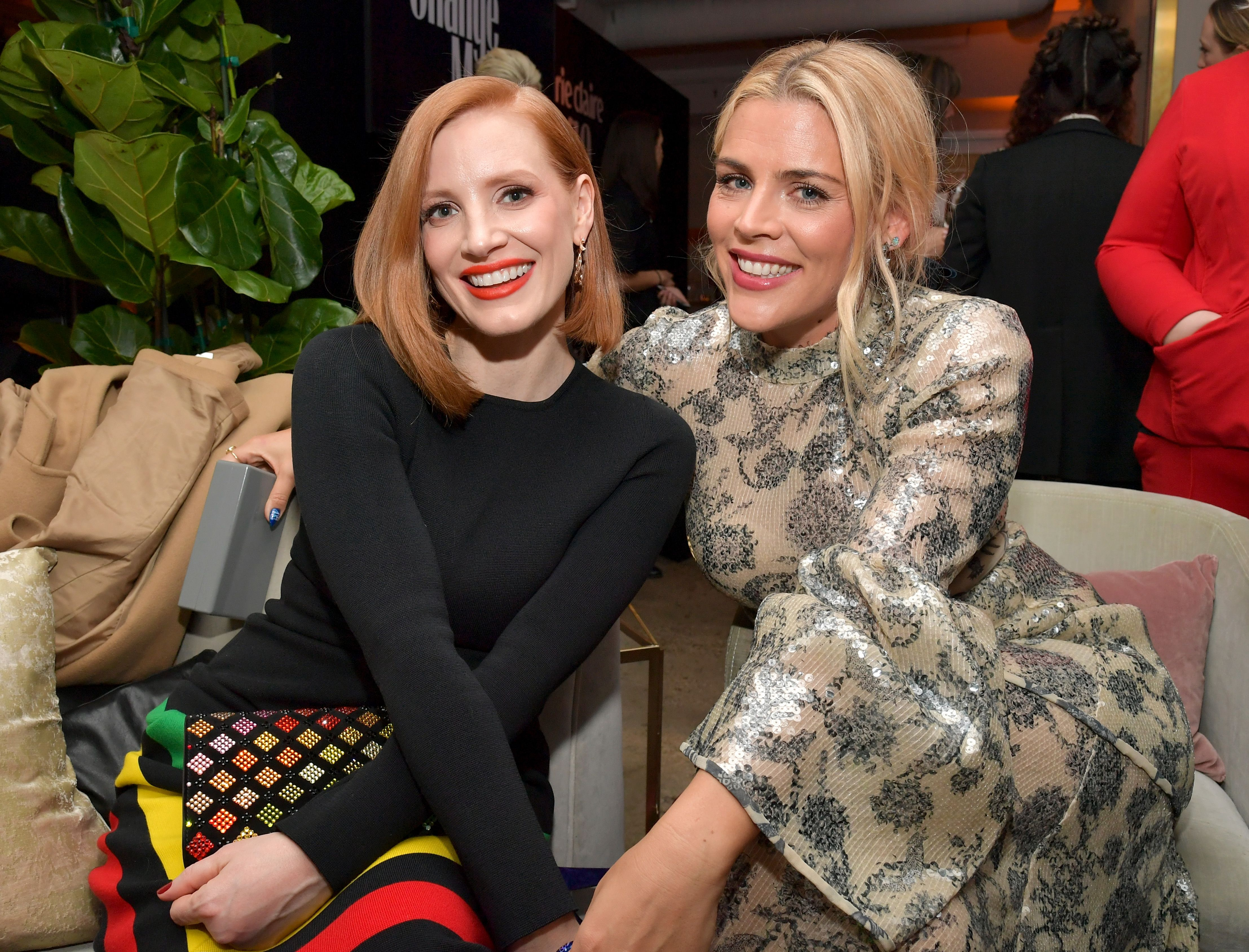 """What I would love to see change in 2019 is for women to continue to talk to each other and maybe discuss issues that in the past have felt taboo,"" Chastain, seen here with Busy Philipps, told us at the Change Makers event in Los Angeles. ""Discuss their salaries. Discuss their coworkers. Maybe discuss a history of abuse or unfair work conditions that they've experienced. Because the one thing that we've really discovered is that the more that we come together and share these stories, the more we can lean on each other and move forward to change the society for everyone."""