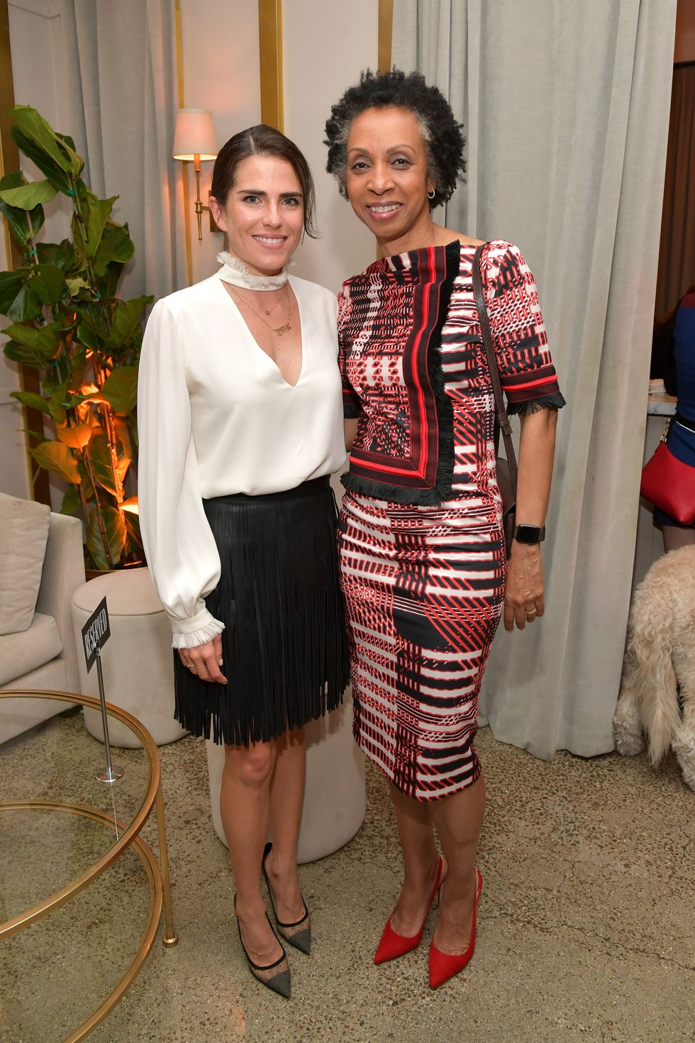 """I feel like history is made on the shoulders of change makers and people who didn't play it safe and who always tried to better the human experience in some way and it was serving others, not themselves,"" actress Karla Souza, pictured here (left) with Nina Shaw, told us at the Change Makers event in Los Angeles. ""So, for me to be invited into this edition of change makers is very humbling and also motivating to keep being part of that history of people who impact society in that way."""