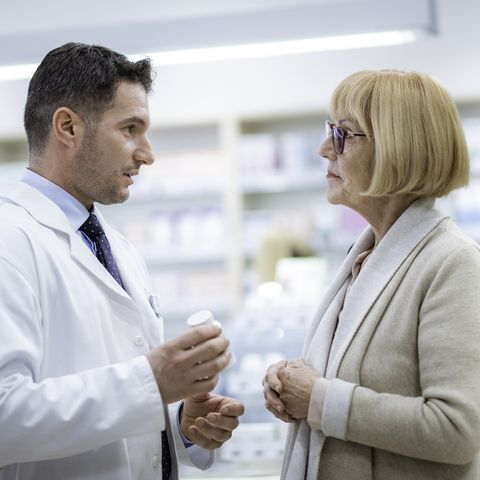 Senior woman consulting with pharmacist