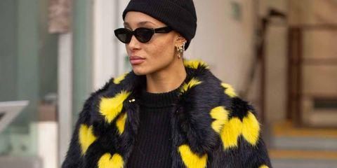 Clothing, Yellow, Street fashion, Outerwear, Fashion, Fur, Sunglasses, Eyewear, Headgear, Coat,