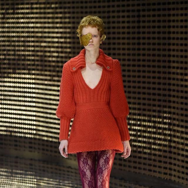 Fashion, Fashion model, Clothing, Fashion show, Red, Footwear, Runway, Outerwear, Fashion design, Tights,