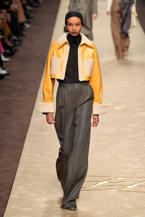Fashion, Fashion model, Fashion show, Runway, Clothing, Yellow, Human, Suit, Street fashion, Event,