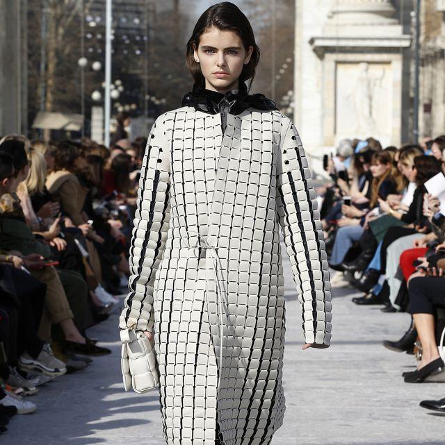 Fashion model, Fashion, Street fashion, Fashion show, Clothing, Runway, Shoulder, Footwear, Black-and-white, Snapshot,