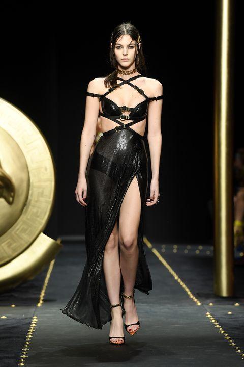Fashion model, Fashion show, Fashion, Black hair, Model, Runway, Thigh, Haute couture, Sandal, Foot,