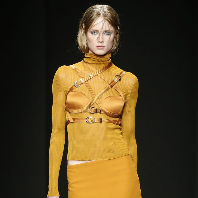 Fashion model, Fashion show, Fashion, Runway, Clothing, Yellow, Shoulder, Fashion design, Haute couture, Event,