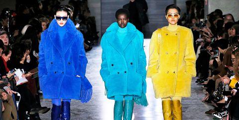 Fashion, Runway, Fashion model, Fashion show, Clothing, Yellow, Street fashion, Fashion design, Outerwear, Human,