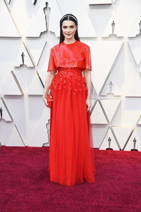 Red carpet, Clothing, Carpet, Dress, Shoulder, Red, Flooring, Fashion model, Gown, Fashion,