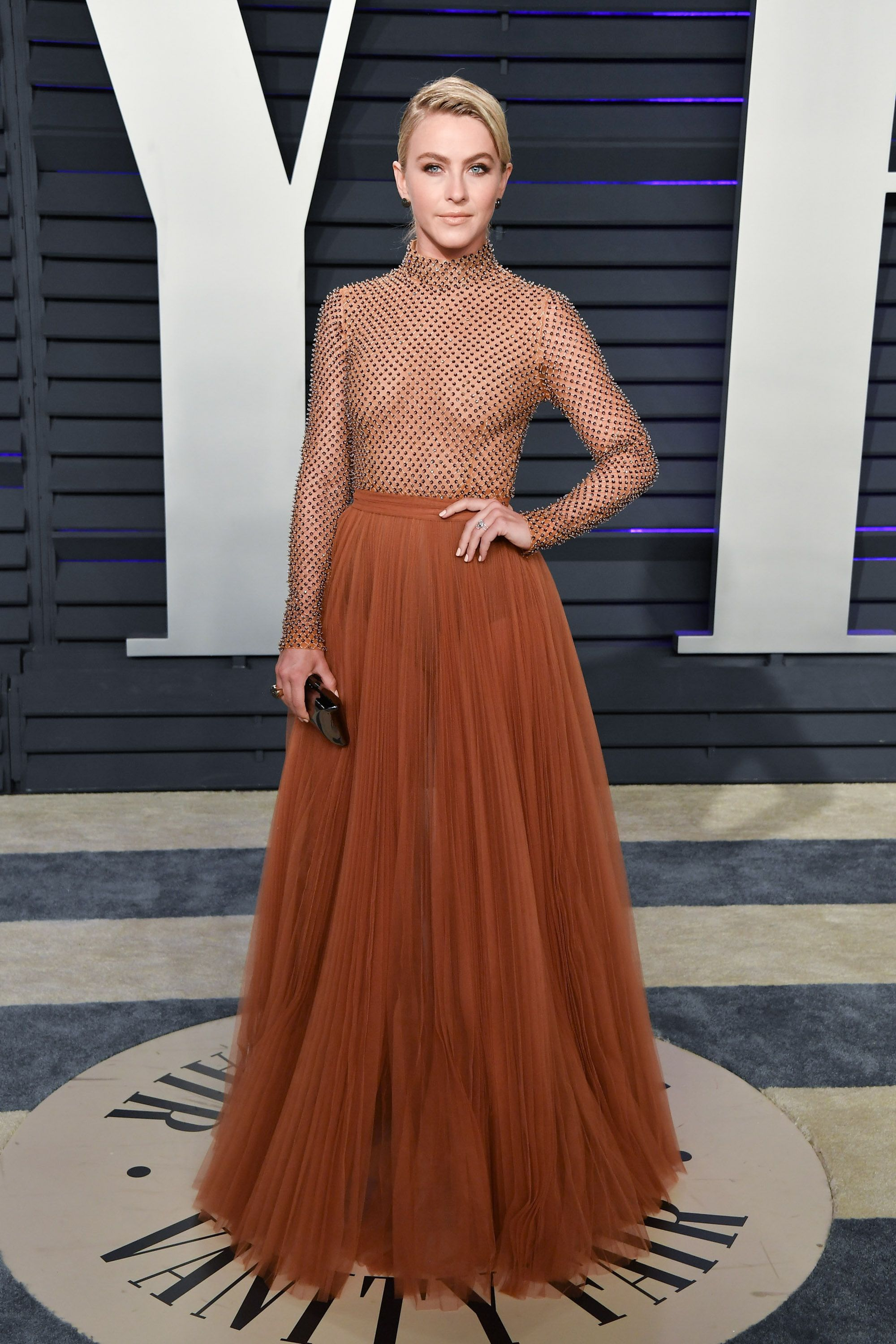 Julianne Hough At Vanity Fair's Oscars after-party, Hough arrived in a caramel-colored J Mendel dress. It was sheer, though not as see-through as Emma Roberts'.