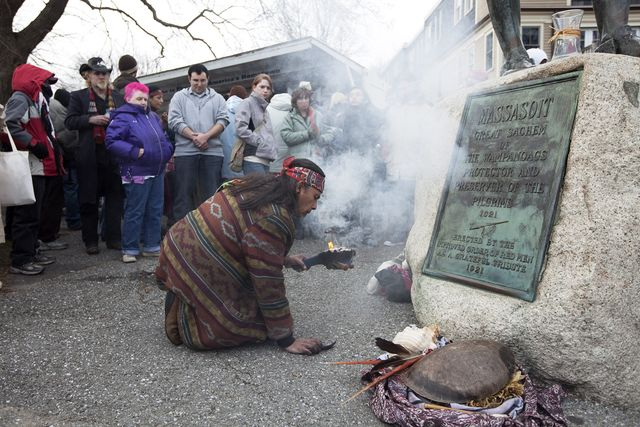 plymouth   november 25 juan gonzalez of boston rekindles a small fire – the smoke symbolizing a ritual for healing and a connection with the creator  he has been attending this  day of mourning for 30 years  we feel the pain of the wampanoag, said gonzalez  united american indians of new england gather for the national day of mourning across from plymouth rock in plymouth, ma on thursday, november 25, 2010  the day signifies the deaths of american indians at the hands of early settlers and colonists and the independence of american indians photo by yoon s byunthe boston globe via getty images