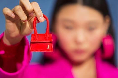 Pink, Skin, Finger, Nail, Lip, Magenta, Cheek, Hand, Material property, Mouth,