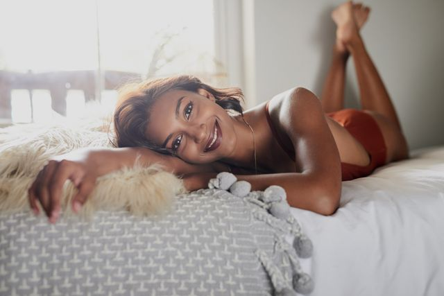 the x factor sex position shot of a beautiful young woman in her bedroom at home