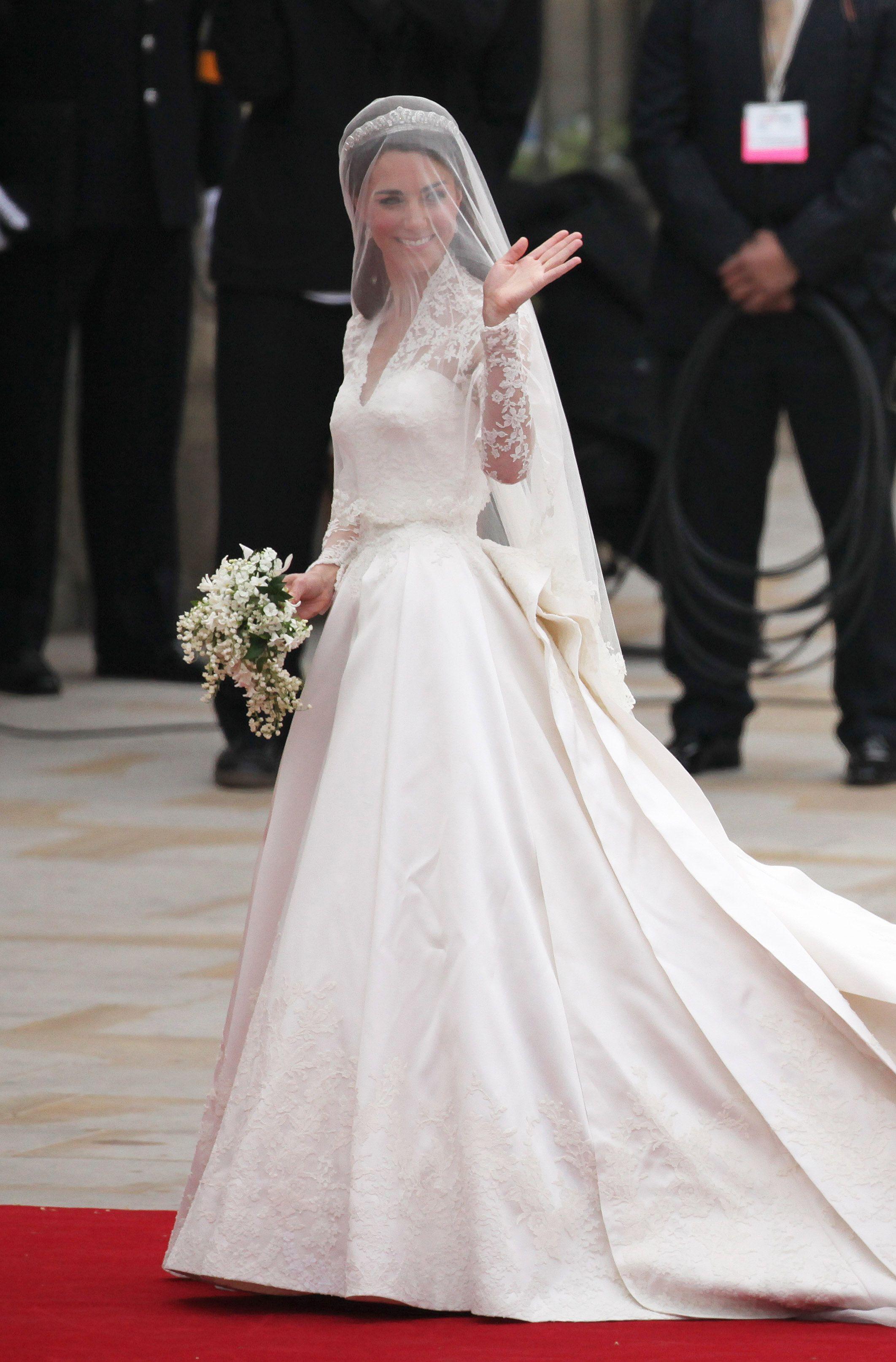Meghan Markles Royal Wedding Dress Compared To Kate Middletons