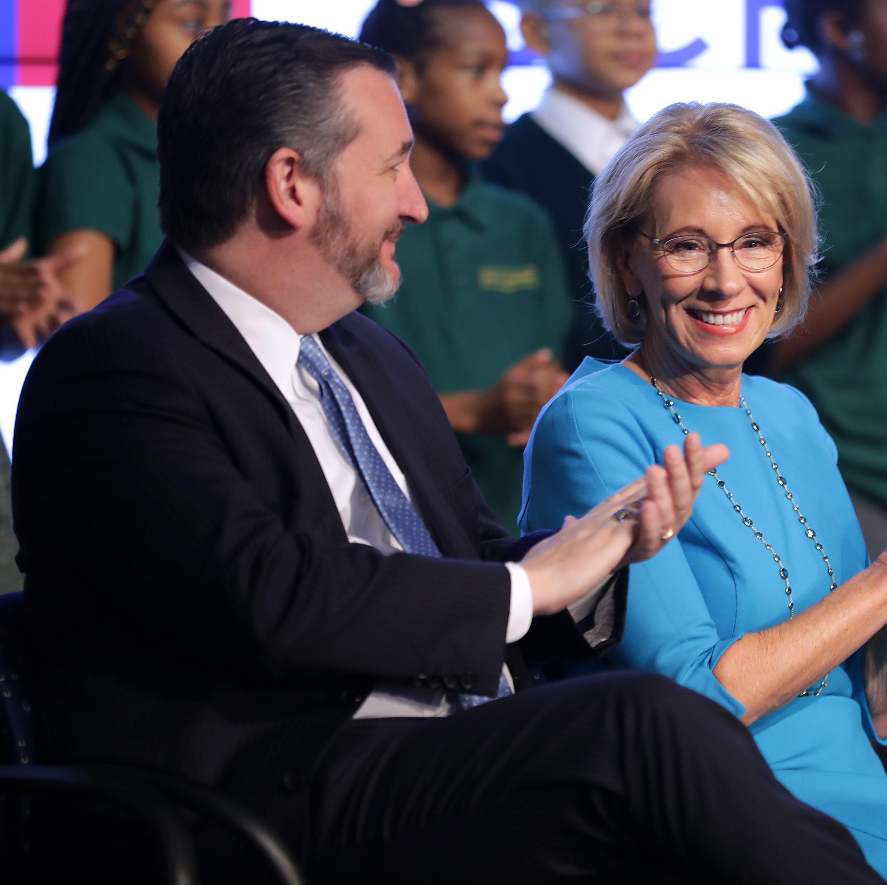 U.S. Education Secretary Betsy DeVos (R) and Sen. Ted Cruz (R-TX) participate in an event about their proposal for Education Freedom Scholarships at the Education Department headquarters February 28, 2019 in Washington, DC.