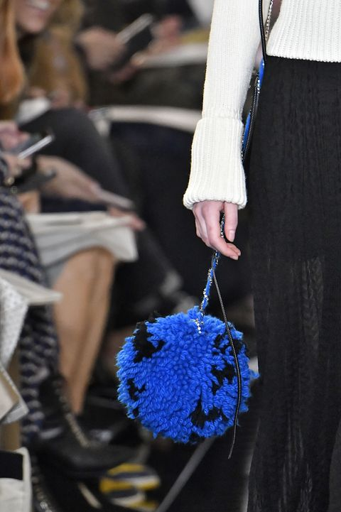 Blue, Cobalt blue, Electric blue, Fashion, Human, Cheerleading, Hand, Street fashion, Pom-pom, Haute couture,
