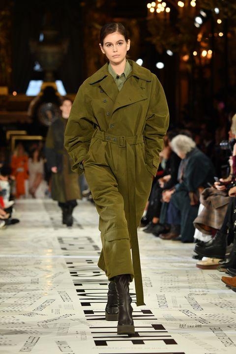 Fashion model, Runway, Fashion, Fashion show, Clothing, Street fashion, Human, Outerwear, Coat, Footwear,