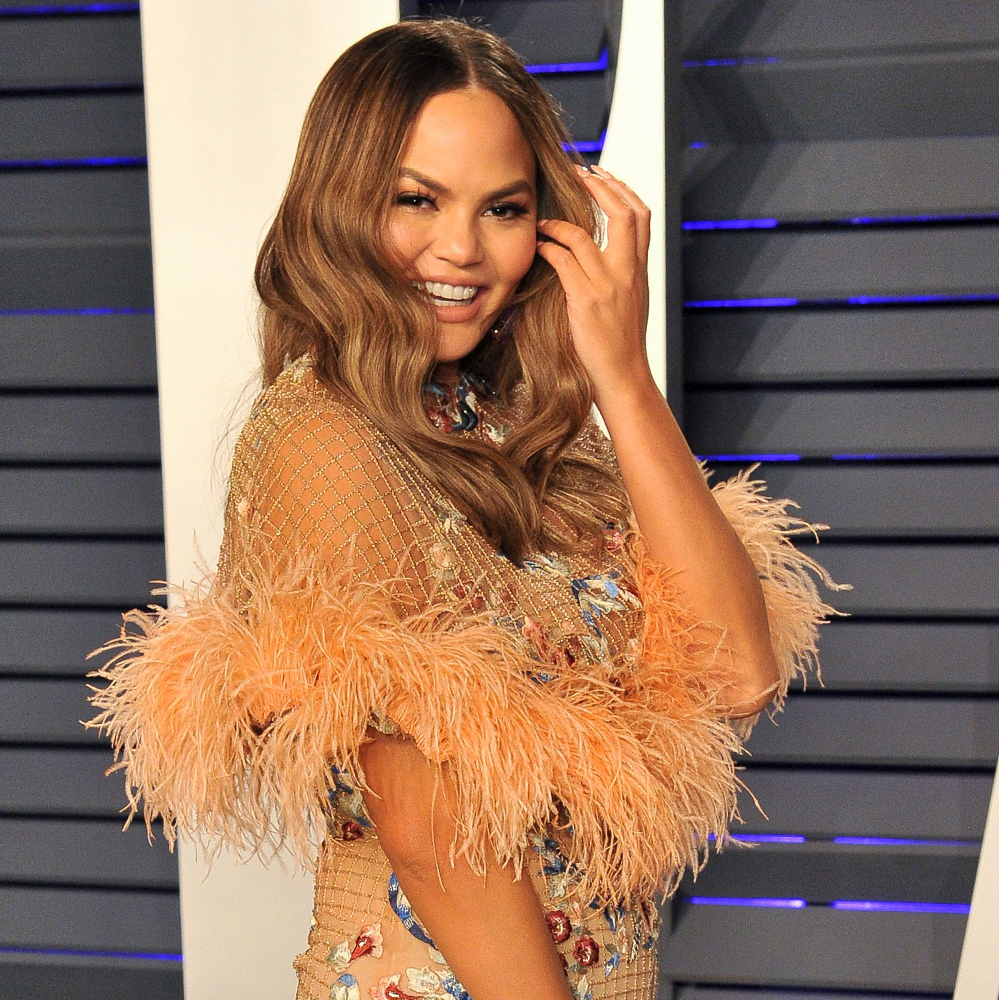 Chrissy Teigen Got an 80's Inspired Bob Hair Makeover and We All Missed it
