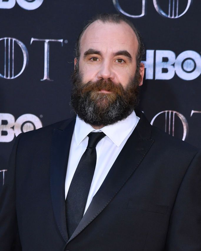 Rory McCann (and beard) The Hound's scars are a bit more intense in the book and ooze red.