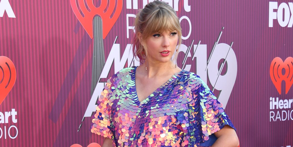 f833e7fef8c Taylor Swift wore a sparkly mermaid playsuit on the IHeartRadio Awards red  carpet