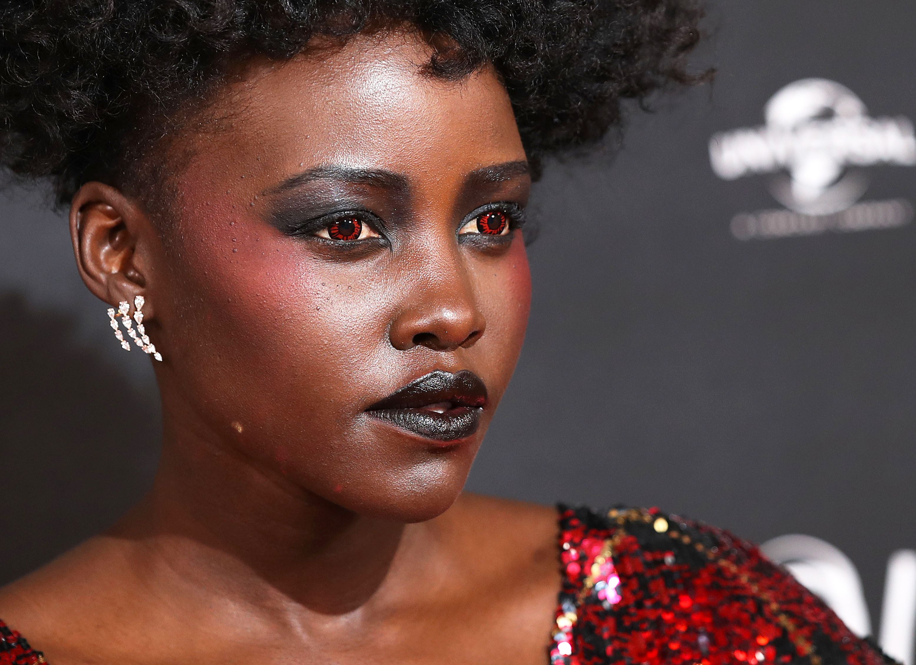 Lupita Nyong O Wore Red Contacts At The London Premiere Of Us