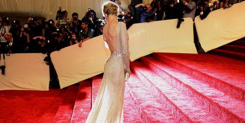 Red carpet, Carpet, Dress, Flooring, Gown, Fashion, Haute couture, Shoulder, Event, Leg,