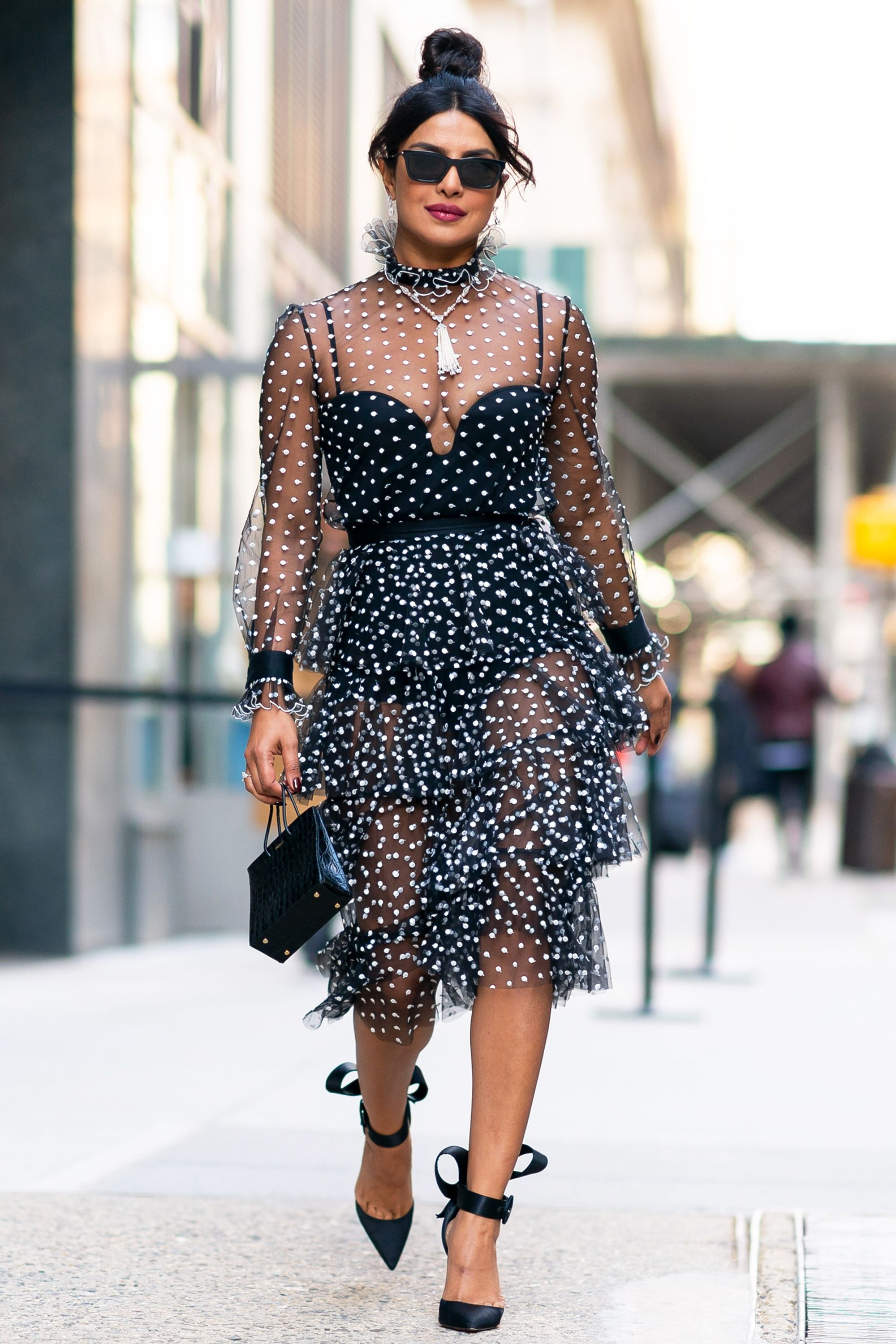 Who: Priyanka Chopra When: March 19, 2019 Wearing: Philosophy di Lorenzo Serafini dress, Christian Louboutin shoes, Medea bag Why: It's officially spring, and nothing makes us more excited than seeing Priyank Chopra in a flirty dress. Spotted in NYC, she wore ruffles, polka dots, and easy black accessories.