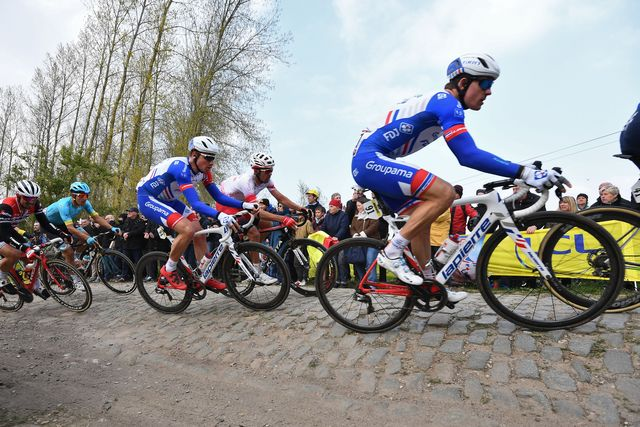 frances groupama   fdj cycling team rides on the pont thibault to ennevelin cobbled stones sector 9 during the 117th edition of the paris roubaix one day classic cycling race, between compiegne and roubaix, near ennevelin, northern france on april 14, 2019 photo by anne christine poujoulat  afp        photo credit should read anne christine poujoulatafp via getty images