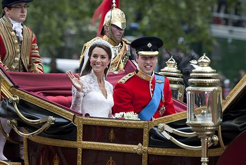 catherine, duchess of cambridge and prince william, duke of cambridge make the journey by carriage in procession to buckingham palace past crowds of spectators following their marriage at westminster abbey, london, 29th april 2011 the marriage of the second in line to the british throne was led by the archbishop of canterbury and was attended by 1900 guests, including foreign royal family members and heads of state thousands of well wishers from around the world have also flocked to london to witness the spectacle and pageantry of the royal wedding photo by tom stoddartgetty images