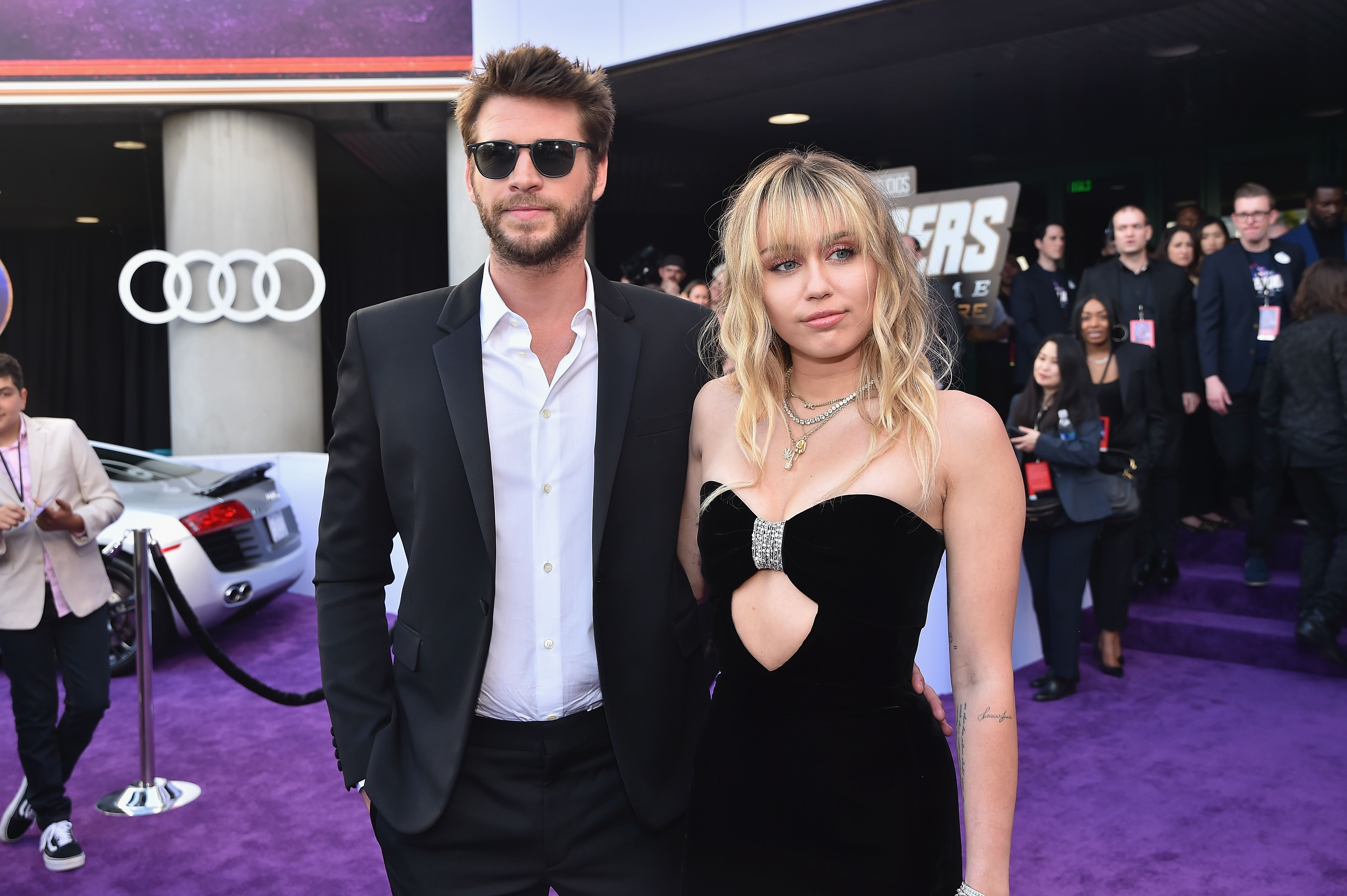 Miley Cyrus Cuts A Slick Figure In Saint Laurent With Husband Chris Hemsworth At Avengers: Endgame Premiere