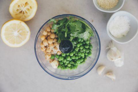 Ingredients for peas hummus, chickpeas, lemon, coriander, garlic, sesame and salt in blender
