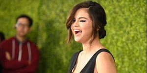 Selena Gomez dior black plunging dress