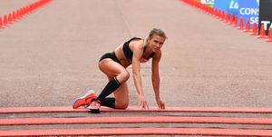 Hayley Carruthers crawls over London Marathon finish line