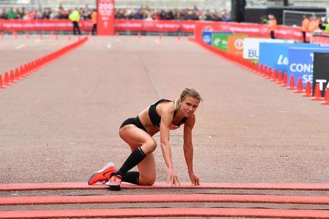 Hayley Carruthers crawls over London Marathon finish line