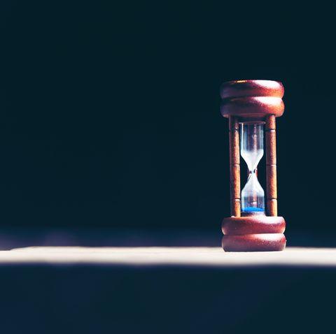 Hourglass, Light, Sky, Still life photography, Photography, Measuring instrument, Glass, Liquid,