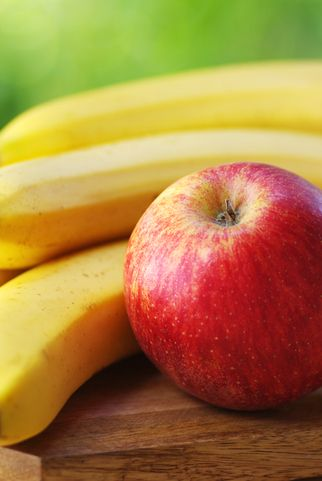 close up of apples and bananas on table