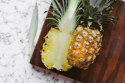 Directly Above Shot Of Halved Pineapple On Cutting Board