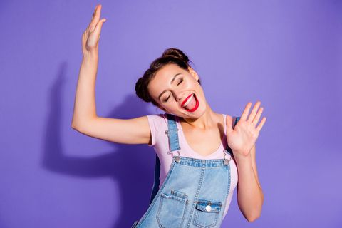 close up photo beautiful amazing she her lady buns toothy hold arms hands raised up karaoke night festive mood funky wear casual t shirt jeans denim overalls clothes isolated purple violet background