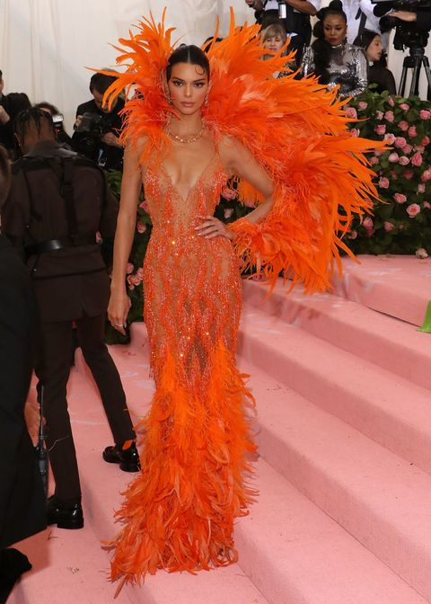 Fashion, Orange, Haute couture, Fashion model, Feather boa, Feather, Event, Fashion show, Shoulder, Fashion design,