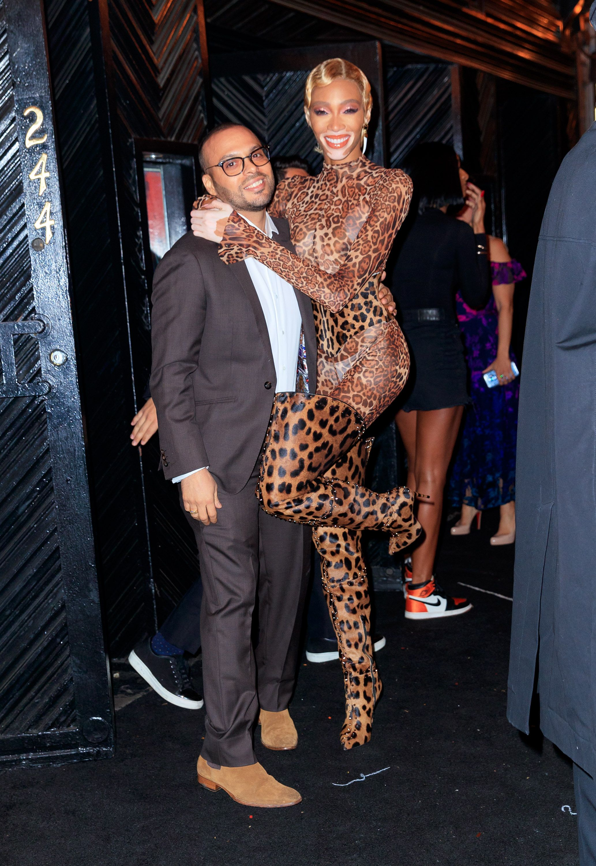 Richie Akiva and Winnie Harlow Winnie Harlow posed with NYC's Up and Down club owner in  a head-to-toe cheetah print catsuit and thigh high boots.
