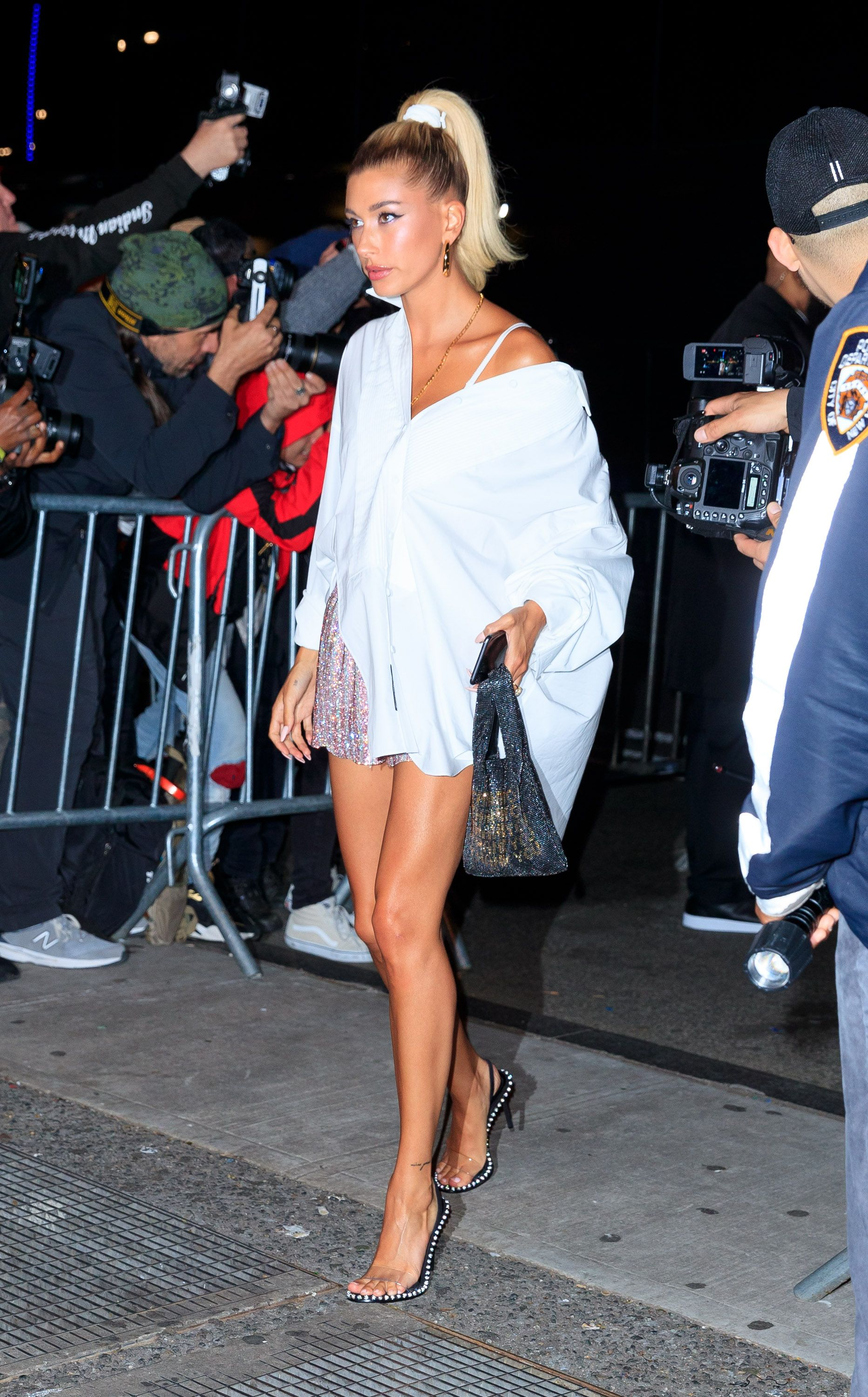 "Hailey Baldwin Hailey Baldwin switched from her Alexander Wang pink gown (with a sparkly ""Wang"" whale tail) to a oversized boyfriend button down and a mini skirt."