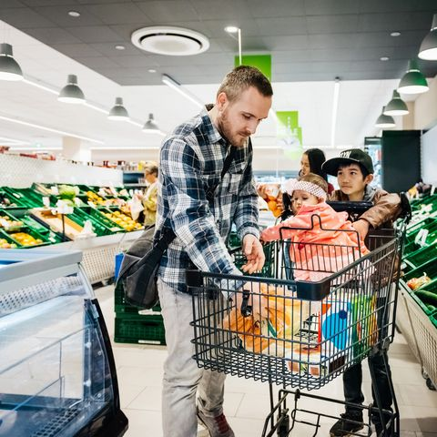 a family buying groceries together at their local supermarket
