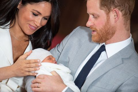 Prince Harry, Duke of Sussex and Meghan, Duchess of Sussex, pose with their newborn son Archie Harrison Mountbatten-Windsor during a photocall in St George's Hall at Windsor Castle on May 8, 2019 in Windsor, England