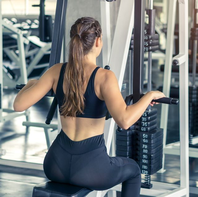 fitness, sport, training and lifestyle concept   young women flexing muscles in fitness gym center