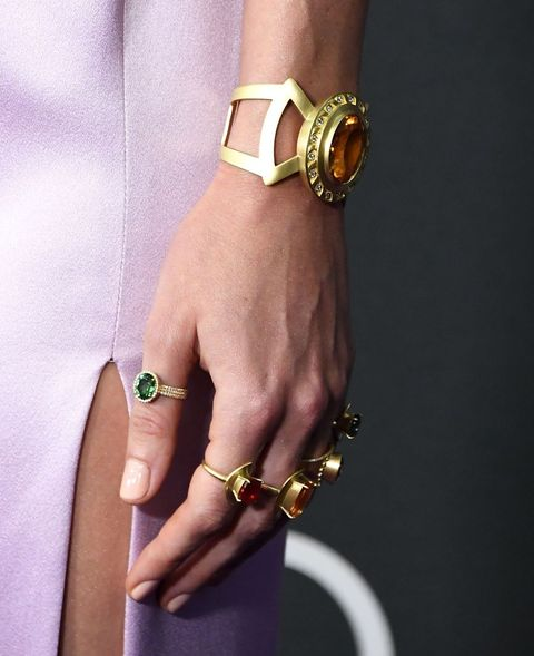 Bracelet, Fashion accessory, Bangle, Jewellery, Yellow, Finger, Hand, Arm, Wrist, Metal,