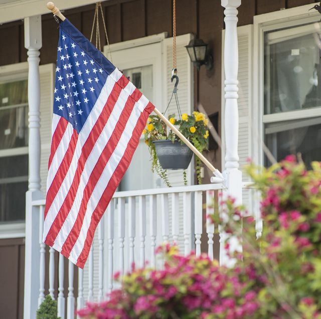 an american home proudly displaying their flag