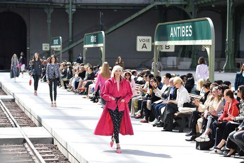 Fashion, Runway, Fashion show, Pink, Street fashion, Transport, Spring, Event, Infrastructure, Crowd,
