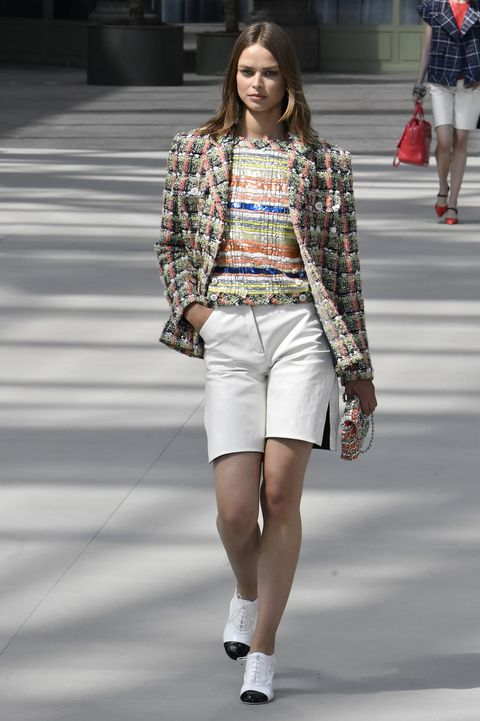 Fashion, Fashion model, Fashion show, Clothing, White, Runway, Street fashion, Shorts, Snapshot, Footwear,