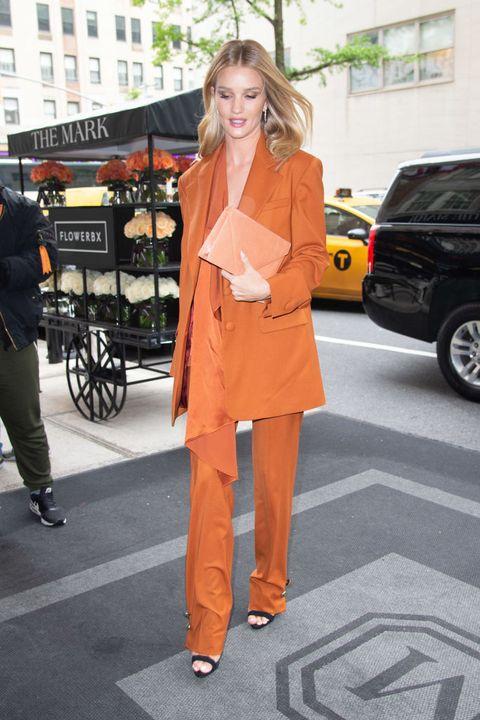 Clothing, Street fashion, Orange, Fashion, Snapshot, Footwear, Yellow, Outerwear, Suit, Shoulder,