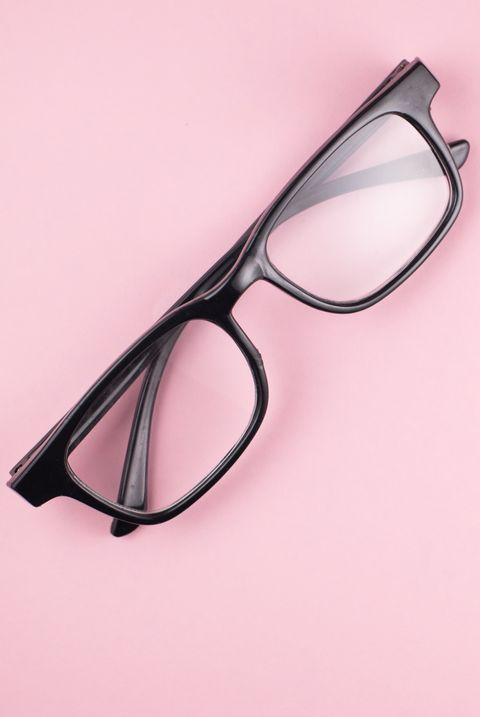 Directly Above View Of Eyeglasses On Pink Background