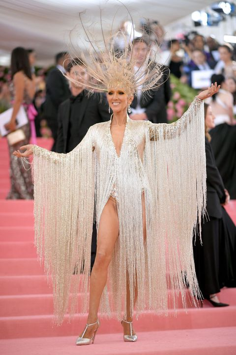 Hair, Fashion, Red carpet, Hairstyle, Haute couture, Fashion model, Pink, Flooring, Dress, Long hair,